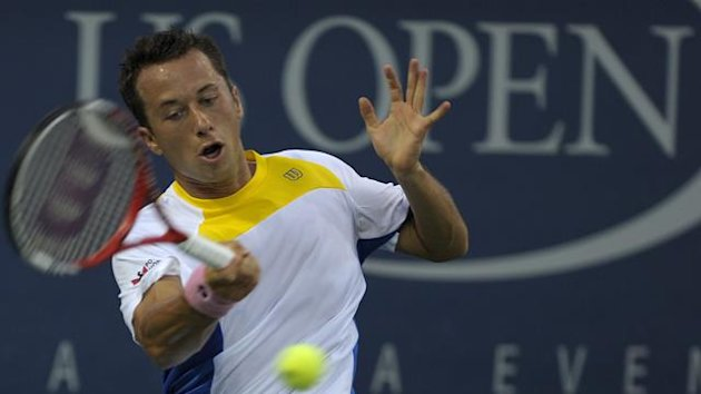 Philipp Kohlschreiber of Germany hits a return to Benoit Paire of France