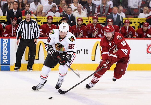 Viktor Stalberg #25 Of The Chicago Blackhawks Skates With The Puck Past Shane Doan #19 Of The Phoenix Coyotes In The Getty Images