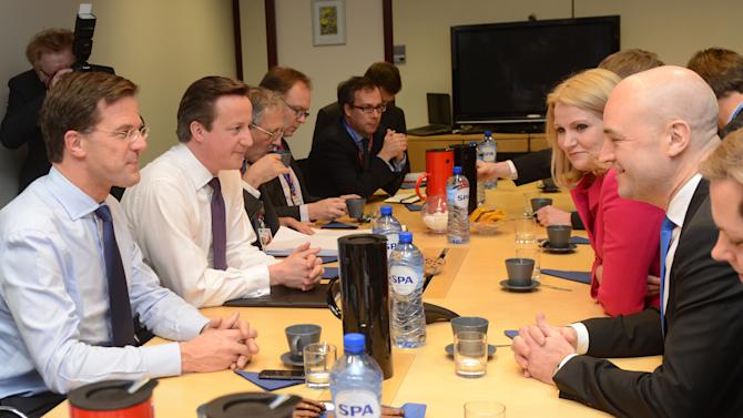 Swedish Prime Minister Fredrik Reinfeldt, right, British Prime Minister David Cameron, second lefd, Dutch Prime Minister Mark Rutte, left, and Denmark's Prime Minister Helle Thorning-Schmidt, second right, talk during a meeting ahead of the EU Budget summit at the European Council building in Brussels, Thursday, Feb. 7, 2013. European Union leaders drew hard lines Thursday ahead of a bracing fight over EU spending for the next seven years that reflects deep divisions over the role of their union. On one side, newer, and generally poorer, members see Europe as a club that is only as strong as its weakest member. Led by Poland, they argue that Europe means nothing if the budget isn't used to bridge the wealth gap and help restart growth. (AP Photo/Laurent Dubrule, Pool)