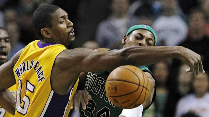Los Angeles Lakers small forward Metta World Peace (15) pressures Boston Celtics forward Paul Pierce, right, on a pass during the second quarter of an NBA basketball game in Boston, Thursday Feb. 9, 2012. (AP Photo/Charles Krupa)