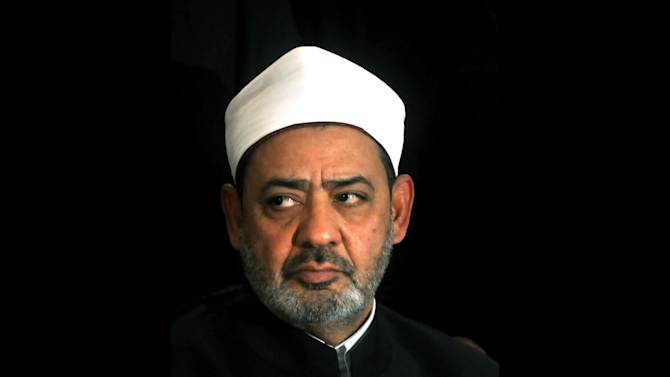 FILE - In this Sunday, Jan. 2, 2011 file photo, Ahmed el-Tayeb the grand sheik of Cairo's Al-Azhar, the pre-eminent theological institute of Sunni Islam, talks to the media in Cairo, Egypt. El-Tayeb said on Wednesday that peaceful protests against the president are permitted, dismissing declarations by Islamist hard-liners that those behind protests planned for June 30 are heretics. (AP Photo, File)