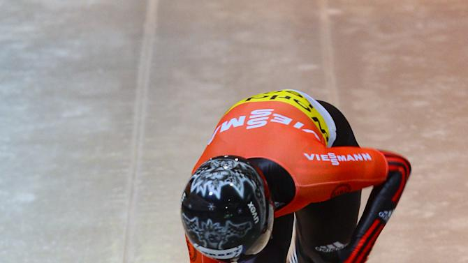 Germany's Marion Thees starts during her first run of the women's Skeleton World Cup race in Koenigssee, Germany, Friday, Jan. 11, 2013. (AP Photo/Kerstin Joensson)