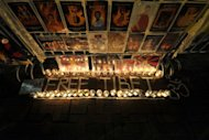 A &#39;Free Tibet&#39; candlelit display showing the pictures of Tibetans who died of self immolation is seen during a protest in front of the Liaison Office of the Central People&#39;s Government in the Hong Kong Special Administrative Region, on February 22, 2012