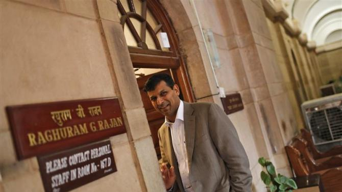 India's chief economic adviser Rajan stands outside his room at the finance ministry in New Delhi