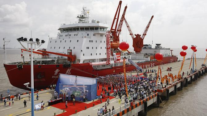 In this photo provided by China's Xinhua News Agency,  Chinese icebreaker Xuelong, or Snow Dragon, is harbored in Shanghai,  after an 85-day scientific quest across the Arctic ocean, Thursday, Sept. 27, 2012.  The Chinese icebreaker has docked at Shanghai after becoming the first Chinese vessel to cross the Arctic Ocean. (AP Photo/Xinhua, Pei Xin) NO SALES