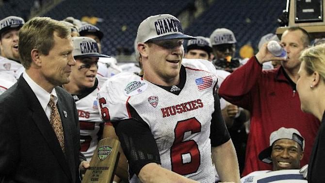 Northern Illinois quarterback Jordan Lynch (6) receives the most valuable player award after the Huskies defeated Kent State 44-37 in the second overtime in the Mid-American Conference championship NCAA college football game on Friday, Nov. 30, 2012, in Detroit. (AP Photo/Carlos Osorio)