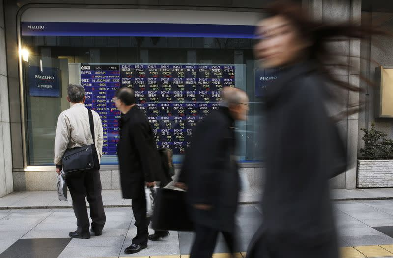 Asia stocks edge up on China rate cut, dollar index at 11-year high