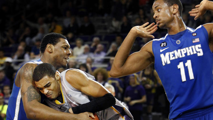 Memphis' Tarik Black, left, struggles against East Carolina's Robert Sampson, middle, as Memphis' Wesley Witherspoon moves out of the way during the second half of an NCAA college basketball game Wednesday, Feb. 8, 2012, in Greenville, N.C. (AP Photo/The Commercial Appeal, Mark Weber)