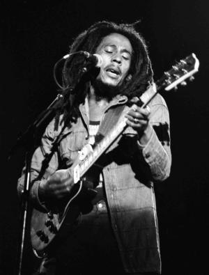 "FILE - In this July 4, 1980 file photo, Jamaican Reggae singer Bob Marley performs at a reggae festival concert  in Paris. ""Marley,"" a documentary about Bob Marley, the charismatic icon of reggae music, directed by  Kevin MacDonald, will be released worldwide on Friday, April 20, 2012, and was premiered in the singer's Caribbean homeland on Thursday. (AP Photo/file)"