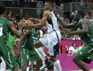 USA's Russell Westbrook threads to the basket against Nigeria during a men's basketball game at the 2012 Summer Olympics, Thursday, Aug. 2, 2012, in London. (AP Photo/Charles Krupa)