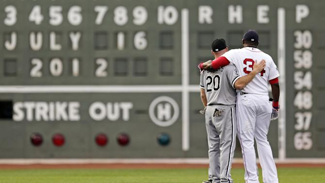 Chicago White Sox third baseman Kevin Youkilis, left, embraces his former teammate, Boston Red Sox designated hitter David Ortiz, during batting practice before a baseball game at Fenway Park in Boston, Monday, July 16, 2012. Youkilis returned to Fenway, where he was a member of the 2004 and 2007 World Series Champion teams, for the first time since being traded. (AP Photo/Charles Krupa)