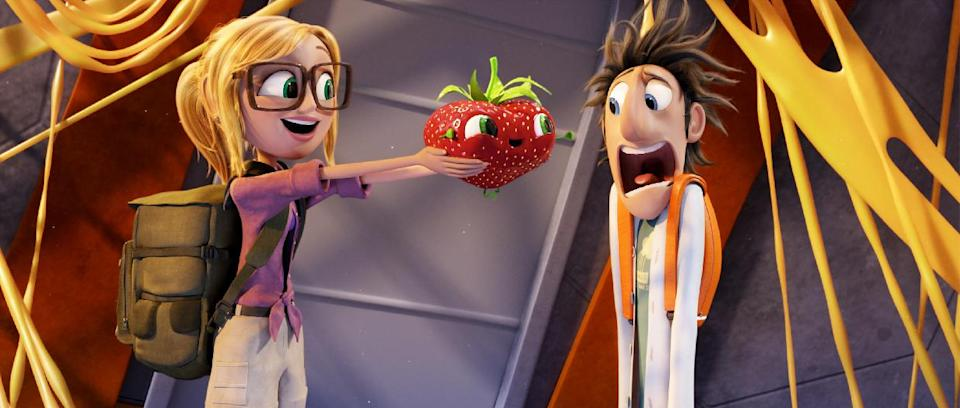 "This film image released by Sony Pictures Animation shows characters, from left, Sam Sparks, voiced by Anna Faris, Barry the Strawberry, voiced by Cody Cameron, and Flint Lockwood, voiced by Bill Hader in a scene from ""Cloudy with a Chance of Meatballs."" (AP Photo/Sony Pictures Animation)"