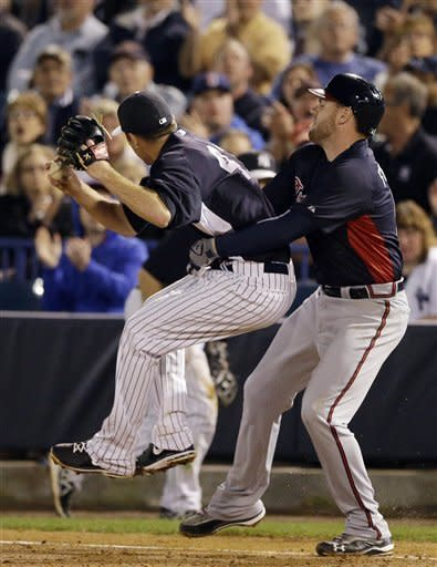 Braves' Uggla hit in neck by pitch, says he's OK