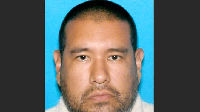This photo provided by the Omaha Police Department shows Dr. Anthony Garcia, 40. The Indiana doctor who was fired from a Nebraska medical school more than a decade ago has been arrested on suspicion of killing four people with ties to the school in two separate attacks five years apart. Garcia, who lives in Terre Haute, Ind., was arrested by Illinois State Police on Monday, July 15, 2013 during a traffic stop in Union County, in southern Illinois. (AP Photo/Omaha Police Department)