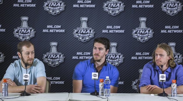 New York Rangers players from left, Derek Stepan, Ryan McDonagh and Carl Hagelin take questions from the media at a news conference in Santa Monica, C...