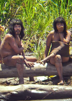 FILE - This Nov. 2011 file photo, shows members of the Mashco-Piro tribe, photographed at an undisclosed location near the Manu National Park in southeastern Peru. More than 100 Mashco-Piro appeared across a river from the remote community of Monte Salvado in Madre de Dios state, says Klaus Quicque the president of the regional FENAMAD indigenous federation on Monday, Aug. 19, 2013. The Maschco-Piro first appeared in May 2011 after more than two decades in voluntary isolation. (AP Photo/Diego Cortijo, Survival International, File)