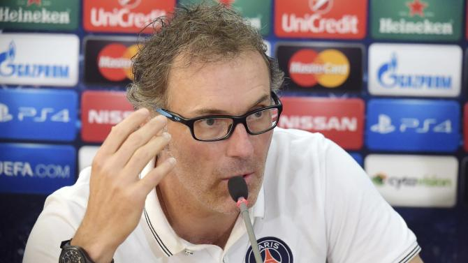 Paris St Germain's coach Laurent Blanc takes part in a news conference at GSP stadium in Nicosia, on the eve of their Champions League soccer match against APOEL Nicosia
