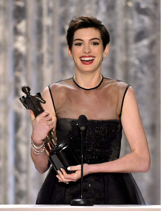 Anne Hathaway accepts the …