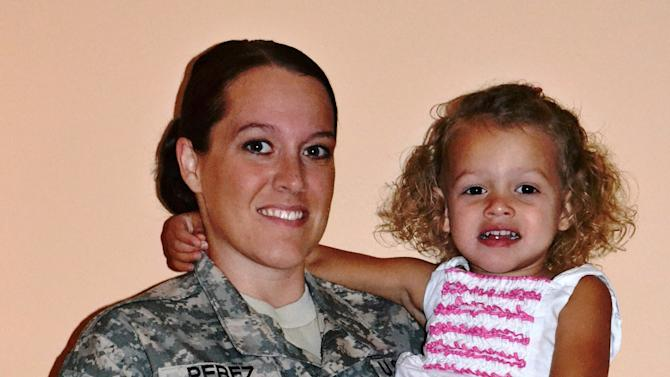 This October 2012 photo provided by the family shows Hayleigh Perez with her daughter, Calleigh. In choosing to serve her country in uniform, Hayleigh Lynn Perez knowingly accepted a nomadic life. Now the former Army sergeant says she and thousands of other veterans trying to get a higher education are being penalized for that enforced rootlessness. (AP Photo/Jose Perez)