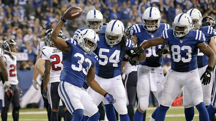 Indianapolis Colts' Vick Ballard (33) reacts following a 1-yard touchdown run during the first half of an NFL football game against the Houston Texans, Sunday, Dec. 30, 2012, in Indianapolis. (AP Photo/AJ Mast)