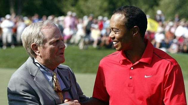 Tiger Woods of the U.S. is congratulated by Jack Nicklaus (L) after his final round of the Memorial Tournament