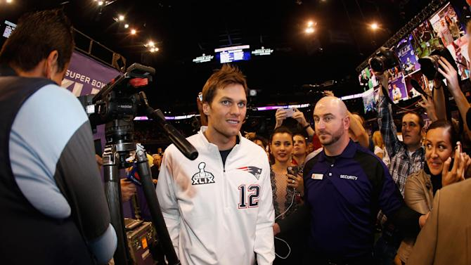 Tom Brady of the New England Patriots walks off the podium during Super Bowl XLIX Media Day Fueled by Gatorade, at U.S. Airways Center in Phoenix, Arizona, on January 27, 2015