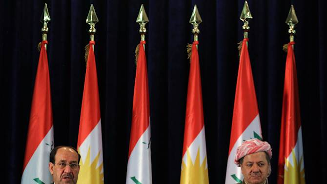Iraqi Prime Minister Nouri al-Maliki, left, and Kurdish regional President Massoud Barzani, attend a press conference after a cabinet meeting in Irbil, 350 kilometers (217 miles) north of Baghdad, Iraq, Sunday, June 9, 2013. Iraq's Prime Minister on Sunday made a rare visit to the country's self-ruled northern Kurdish region in a bid to melt the ice between the Kurds and the Shiite-led central government in Baghdad, as a suicide attack in Baghdad claimed the lives of seven people. (AP Photo/Ceerwan Aziz)