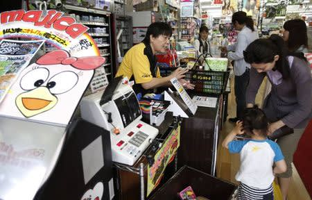 File photo of shoppers lining up in front of cashiers at Don Quijote's central branch store in Tokyo
