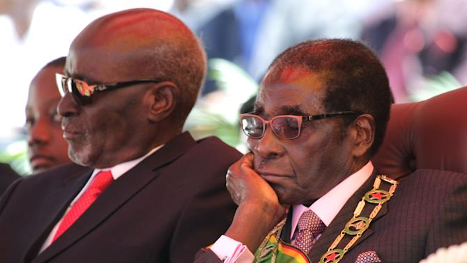 """Zimbabwean president Robert Mugabe, attends celebrations to mark 32 years of independence  in Harare, Wednesday, April 18, 2012. In his address Mugabe said that political violence must be """"buried in the past"""" to move the nation toward free and unhindered elections. (AP Photo/Str)"""
