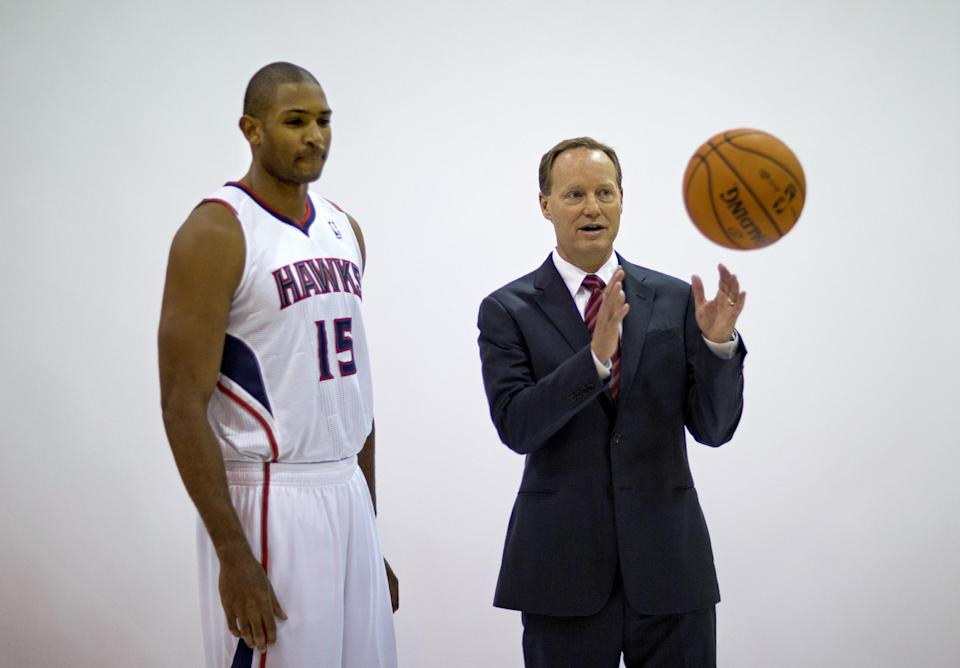 New Hawks coach steers away from DUI questions