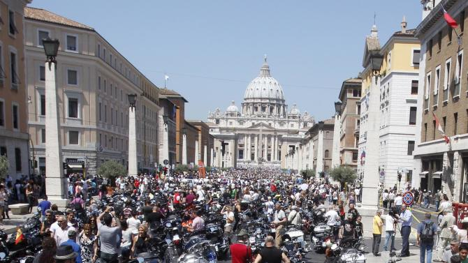 Harley-Davidson motorcycles are parked in Via della Conciliazione leading to St. Peter's Square during a Mass celebrated by Pope Francis, at the Vatican, Sunday, June 16, 2013. Pope Francis on Sunday blessed thousands of Harley Davidsons and their riders as the American motorcycle manufacturer celebrated its 110th anniversary with a loud parade and plenty of leather. (AP Photo/Riccardo De Luca)
