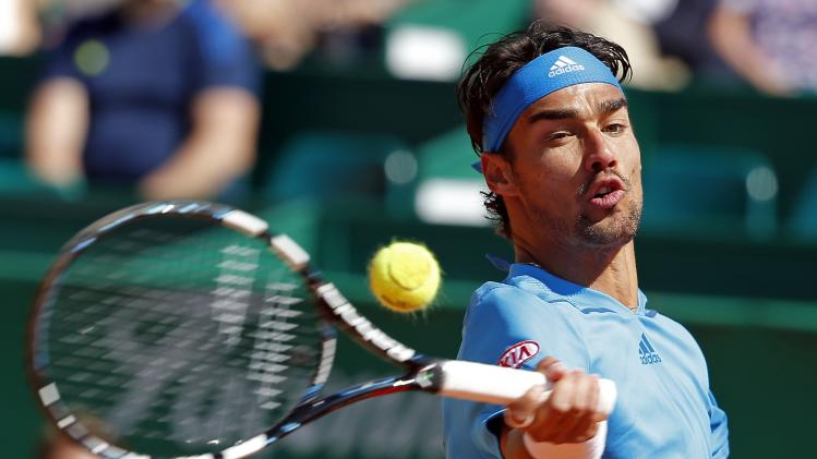 Fabio Fognini of Italy returns the ball to Jo-Wilfried Tsonga of France during the Monte Carlo Masters in Monaco