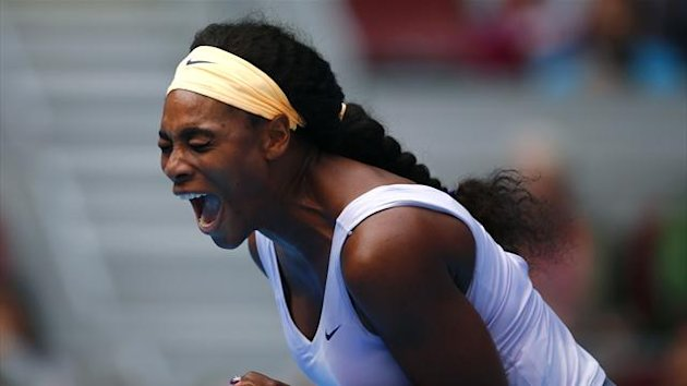 Serena Williams of the U.S. reacts after winning a point during her women's singles match against Maria Kirilenko of Russia at the China Open tennis tournament in Beijing October 3, 2013 (Reuters)