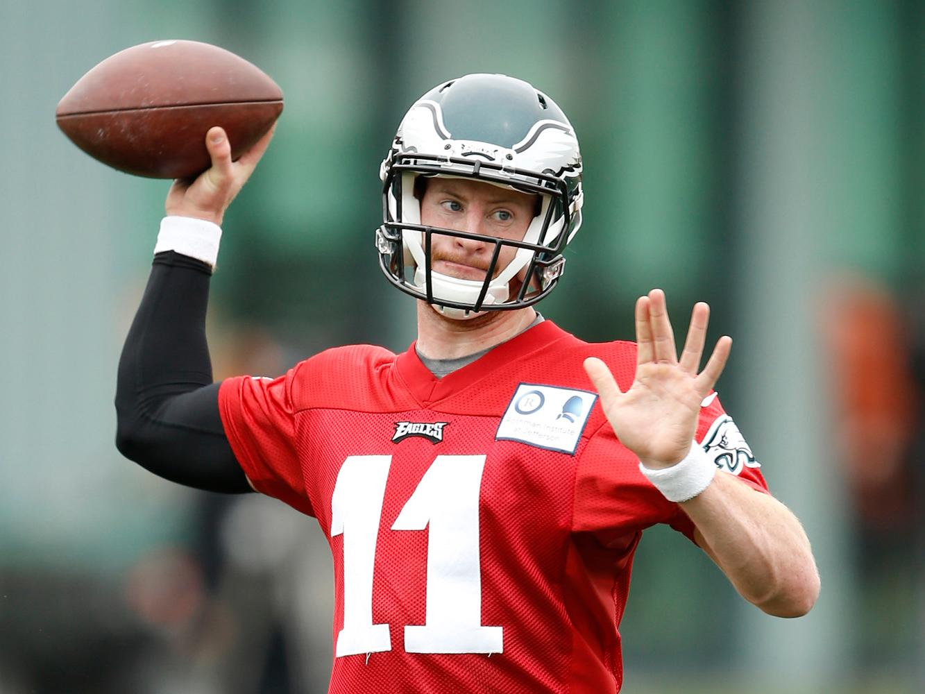 Carson Wentz is turning heads at workouts, and it sounds like Sam Bradford's grip on the starting job is slipping