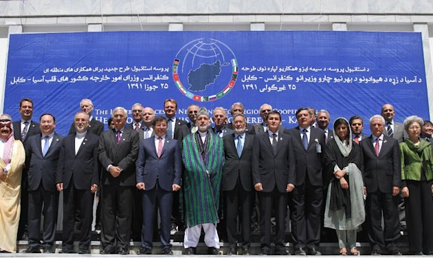 Afghan President Hamid Karzai, center, posees for a group photo with the foreign attendees of the Asia Ministerial Conference at the foreign ministry in Kabul, Afghanistan, Thursday, June 14, 2012. Af