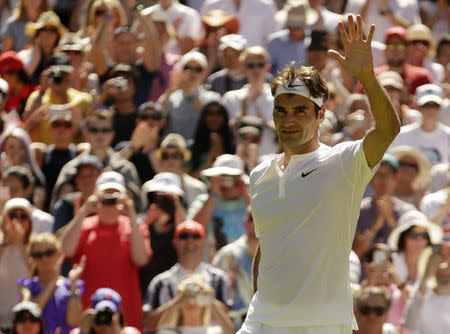 Roger Federer of Switzerland waves to fans after winning his match against Damir Dzumhur of Bosnia and Herzegovina at the Wimbledon Tennis Championships in London