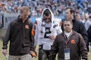 Cleveland Browns' Johnny Manziel (2) is helped off the field after being injured in the first half of an NFL football game against the Carolina Panthers in Charlotte, N.C., Sunday, Dec. 21, 2014. (AP Photo/Chuck Burton)