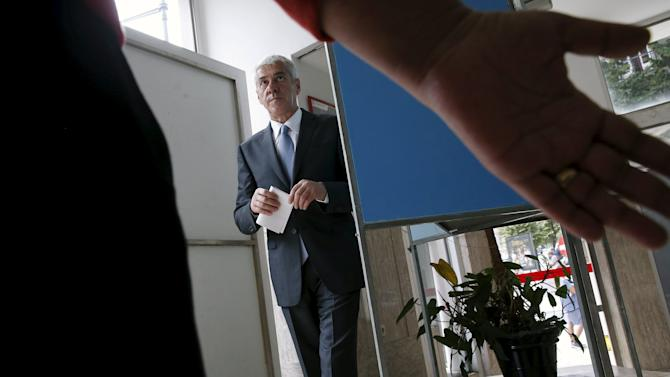 Former Portuguese Prime Minister Jose Socrates prepares to vote in the Portuguese general election at a polling station in Lisbon
