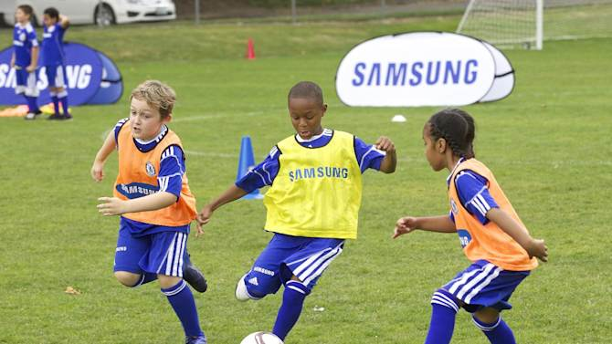 COMMERCIAL IMAGE -  Campers from Seattle-area Boys & Girls Club of America scrimmage he Samsung-Chelsea FC Youth Football Camp at Starfire Sports Complex on Tuesday July 17, 2012 near Seattle. (Photo by Stephen Brashear/Invision for Samsung Electronics America/AP Images)