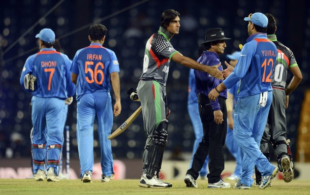 Afghanistan's Shapoor Zadran shakes hands with India's Yuvraj after India defeated his team in the ICC World Twenty20 group A match at the R Premadasa Stadium, Colombo
