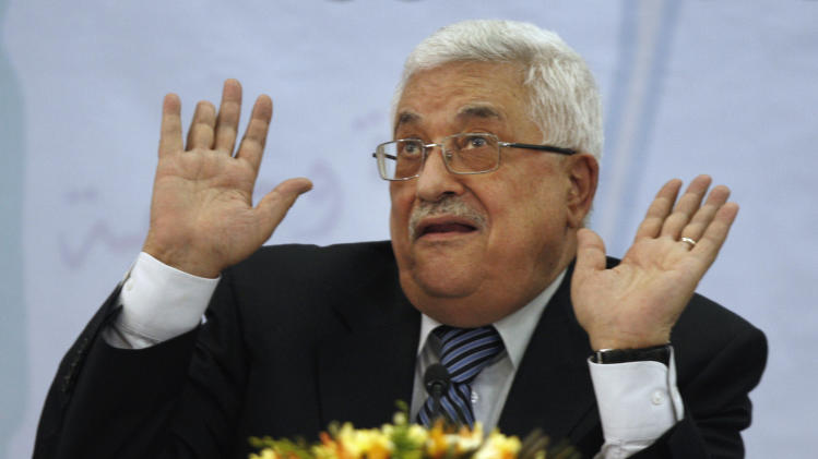 Palestinian President Mahmoud Abbas gestures as he speaks during a meeting of the Central Committee of the Palestine Liberation Organization (PLO), in the West Bank city of Ramallah, Wednesday, July 27, 2011. Abbas said Wednesday he will ask the United Nations to endorse Palestinian independence this fall even if negotiations restart with Israel. (AP Photo/Majdi Mohammed)