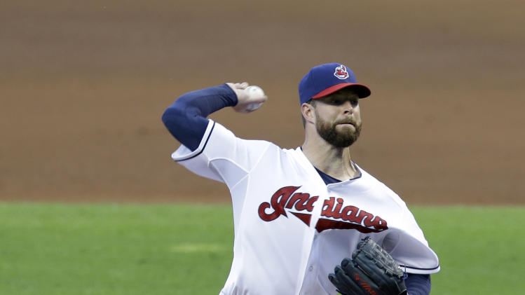 Cleveland Indians starting pitcher Corey Kluber delivers in the fifth inning of a baseball game against the Seattle Mariners Wednesday, July 30, 2014, in Cleveland. Kluber pitched nine innings and gave up three hits. The Indians defeated the Mariners 2-0. (AP Photo/Tony Dejak)