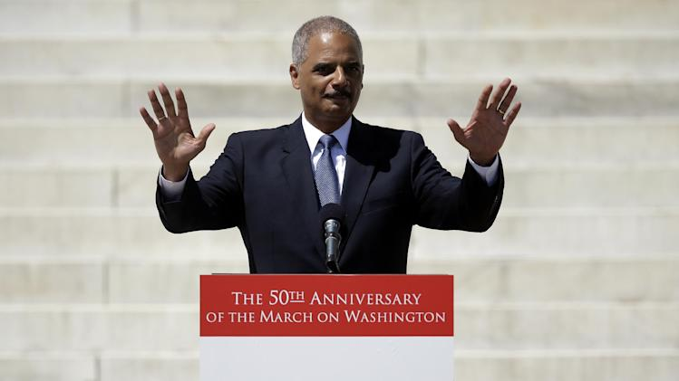 """ADDING SECOND SENTENCE TO CAPTION - Attorney General Eric Holder acknowledges applause before speaking at a rally to commemorate the 50th anniversary of the 1963 March on Washington on the steps of the Lincoln Memorial in Washington Saturday, Aug. 24, 2013. Holder, the nation's first black attorney general, said he would not be in office, nor would Barack Obama be president, without those who marched. """"They marched in spite of animosity, oppression and brutality because they believed in the greatness of what this nation could become and despaired of the founding promises not kept,"""" Holder said. (AP Photo/Carolyn Kaster)"""