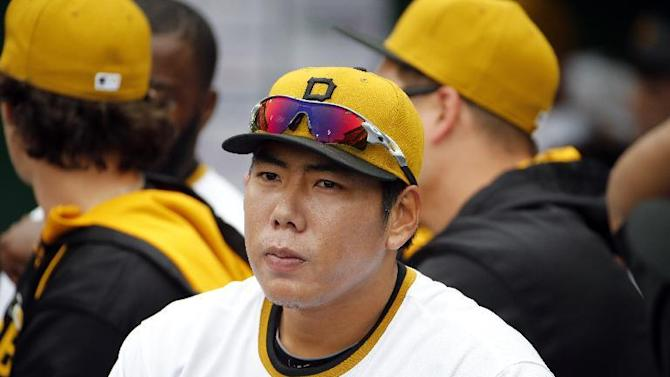 Pittsburgh Pirates' Jung Ho Kang of Korea sits in the dugout during a baseball game against the Milwaukee Brewers in Pittsburgh, Sunday, April 19, 2015. (AP Photo/Gene J. Puskar)