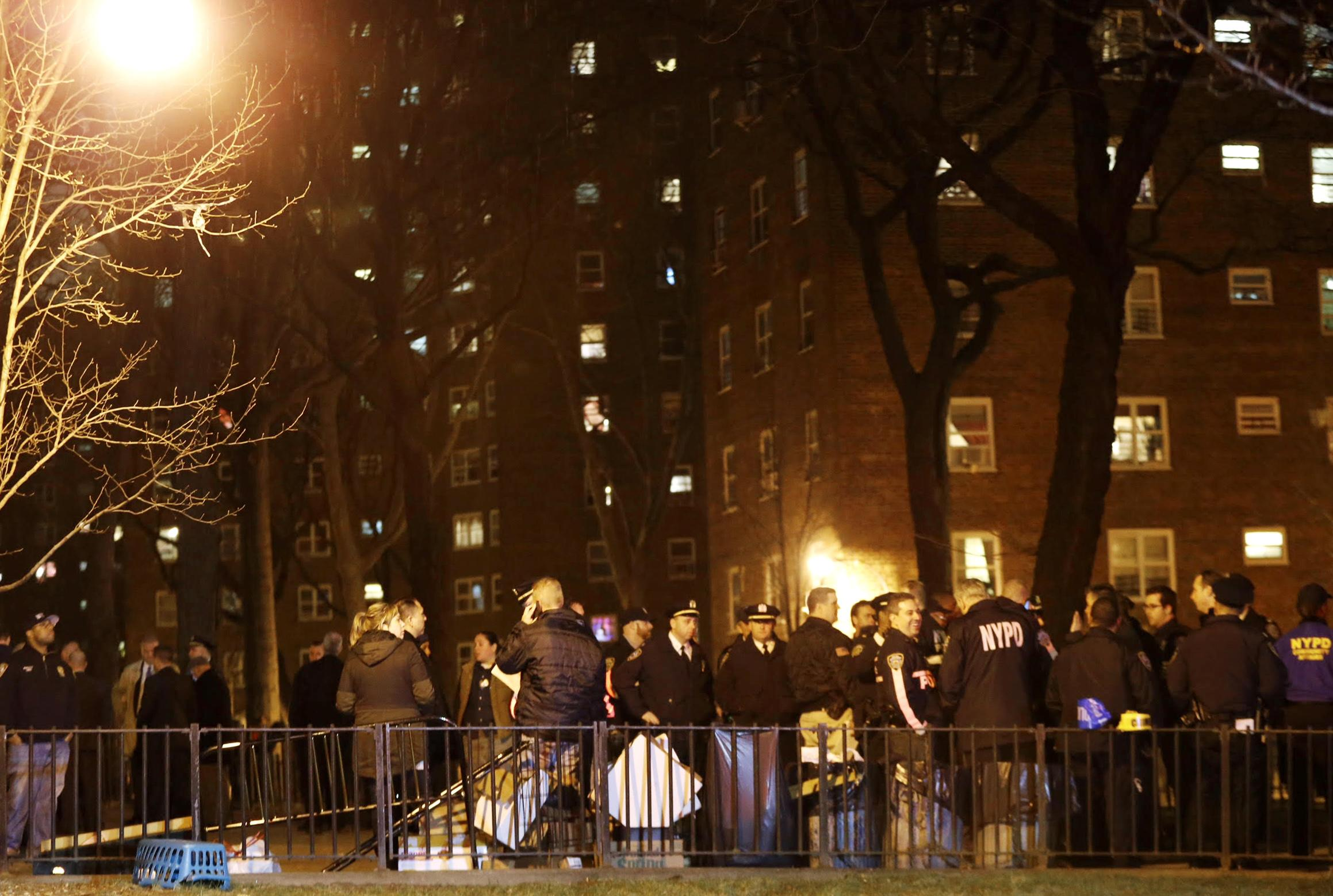 The Latest: 1 wounded NYPD officer to leave hospital