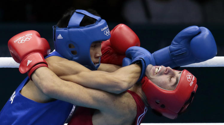 FILE - In this Friday, Aug. 10, 2012 file photo, Russia's Misha Aloian, right, fights Mongolia's Tugstsogt Nyambayar during their men's flyweight 52-kg semifinal boxing match at the 2012 Summer Olympics, in London. (AP Photo/Ivan Sekretarev, File)