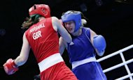Savannah Marshall of Great Britain (in red) defends against Marina Volnova of Kazakhstan (in blue) during the women's Middleweight boxing quarterfinals of the 2012 London Olympic Games at the ExCel Arena in London. Britain's world champion and middleweight favourite Marshall suffered a shock Olympic Games quarter-final exit on Monday, falling to defeat in her opening bout