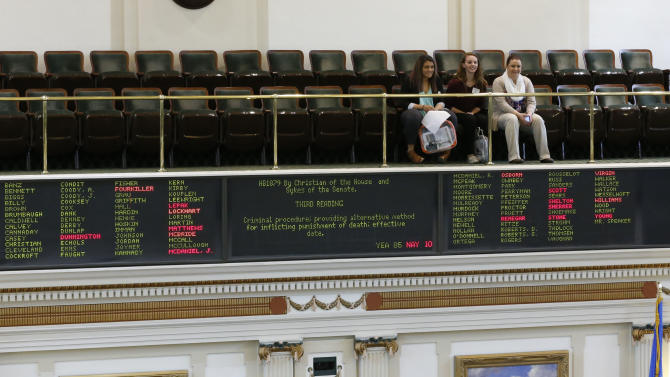 Visitors in the gallery watch the activity on the floor of the Oklahoma House as voting on a bill to change the alternate form of execution in Oklahoma is shown on the voting board below them, in the Oklahoma House in Oklahoma City, Tuesday, March 3, 2015. (AP Photo/Sue Ogrocki)
