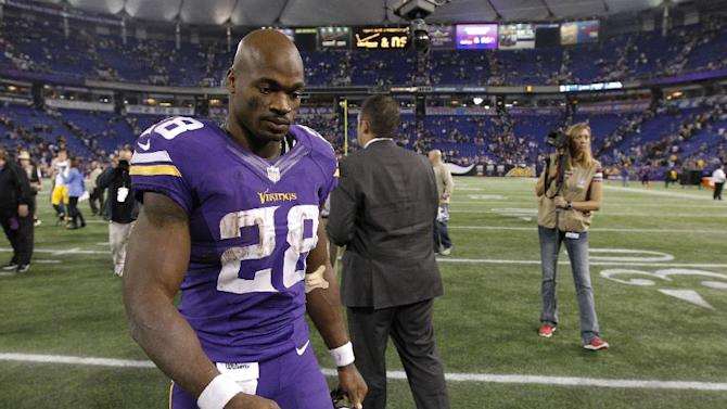In ths Oct. 7, 2013, file photo, Minnesota Vikings running back Adrian Peterson (28) walks off the field after an NFL football game against the Green Bay Packers in Minneapolis. After enduring the fallout from child abuse allegations against star running back Adrian Peterson, the Vikings first-year coach Mike Zimmer might benefit from visiting an old friend in the football business. He'll do so this Sunday when he sees Saints coach Sean Payton in the New Orleans, though the timing is far from ideal