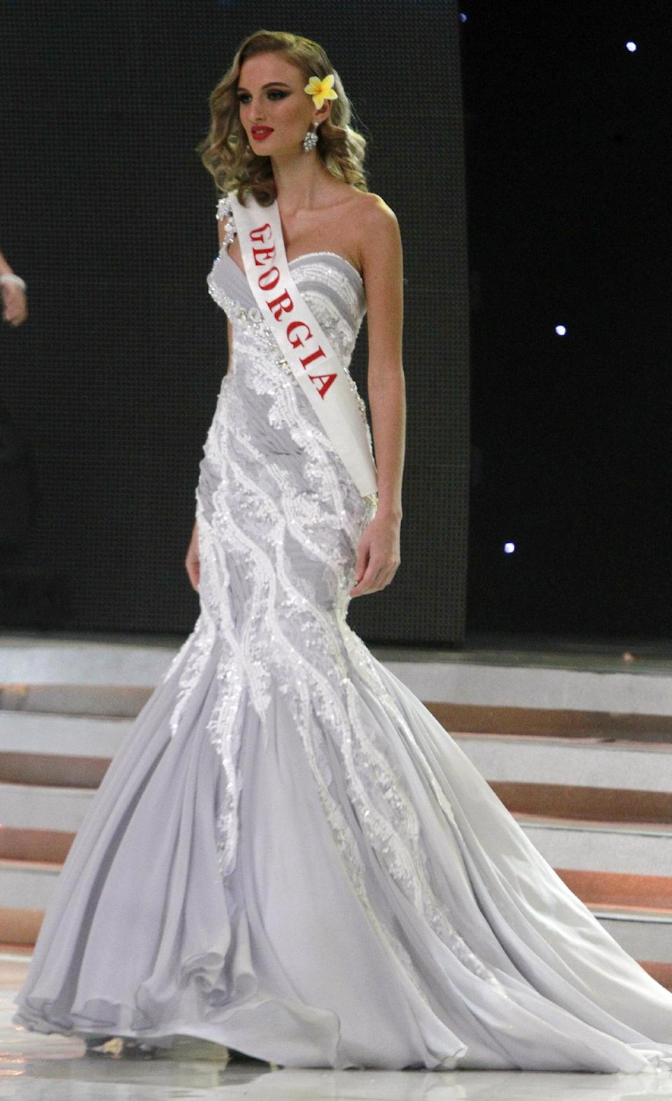 Miss Georgia Tamar Shedaniai walks on stage during opening of the 63rd Miss World Pageant ceremony in Nusa Dua, Bali, Indonesia on Sunday, Sept. 8, 2013. (AP Photo/Firdia Lisnawati)